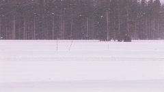 A cross country skier moves across a snowy landscape. Stock Footage
