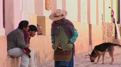 A latin American woman walks down a street in a South American town. Stock Footage