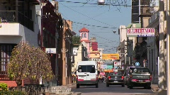 Argentina town with cars and businesses with signs in Spanish Stock Footage