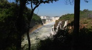 A zoom into Iguacu Falls with a rainbow in the foreground. Stock Footage