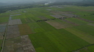 Stock Video Footage of Helicopter fight over rural area with fields in different stages of harvest and