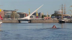 Stock Video Footage of Buenos Aires harbor with sail boat and bridge Puerto Madero