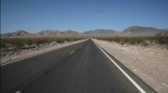 A highway runs through the desert. Stock Footage