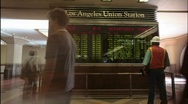 A time lapse of passengers looking at train arrivals and Stock Footage
