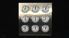 Nine different clock timers rotate at similar speeds. Stock Footage