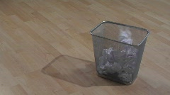 Pieces of waste paper are thrown into a garbage can. Stock Footage