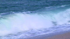 Ocean waves gently crest on the shore. Stock Footage