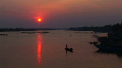 The sun sets behind the Mekong River in Vietnam. Stock Footage