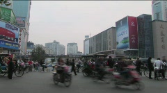 Traffic moves along a busy boulevard in Beijing China. Stock Footage