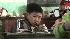 Children practice writing in a rural classroom in China. Stock Footage