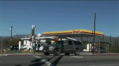 A time lapse shot of a gas station as traffic moves quickly by. Stock Footage