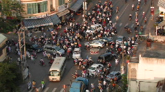 Pedestrian and motor traffic at a busy three-way intersection. Stock Footage