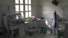 Nurse taking care of a new born baby in birth center in a third world hospital Stock Footage