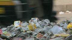 Cars and bikes driving past trash. Stock Footage