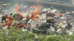 Garbage burns near a railway. Stock Footage