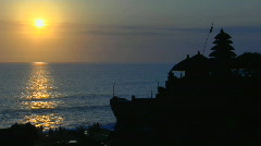 The sun shines over the water near the Pura Tanah Lot Stock Footage
