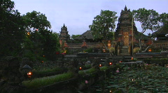 A beautiful Balinese temple has a pond of lily pads in front. Stock Footage