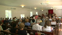 The interior of a small town church with many worshippers. Stock Footage