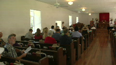 Pan across the interior of a small town church with many - stock footage