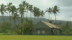 A church stands on a tropical island during a wind storm. Stock Footage