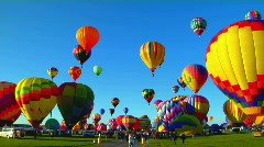 Pan across beautiful balloons launching at the Albuquerque - stock footage