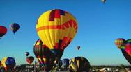 Balloons float across the sky at the Albuquerque balloon festival. Stock Footage
