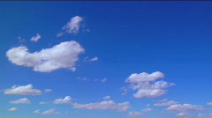 Time lapse clouds moving against a blue sky. Stock Footage