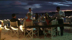 Patrons dine at an outdoor beach restaurant. Stock Footage