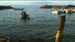 A motor boat tethered to a dock rocks in the waves. Stock Footage