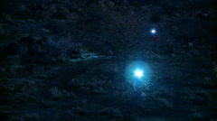 A couple of people ride their bikes at night time. Stock Footage