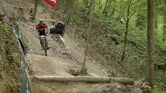 Cyclist race along a rough dirt road course. - stock footage