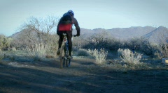 Several bikers ride on a mountain trail. Stock Footage