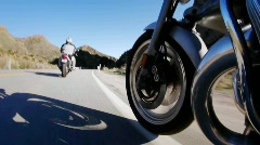 Two motorcycle riders take to the open road in the country side. Stock Footage
