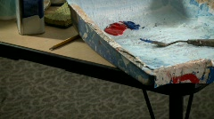 Painting supplies are laid out on a table. Stock Footage