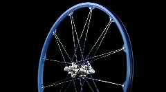 A blue wheel with spokes revolves. Stock Footage