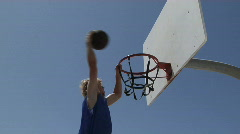 A basketball player slam dunks while standing on a step ladder. Stock Footage