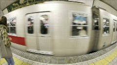 Passengers enter and exit subway cars in Osaka, Japan. Stock Footage