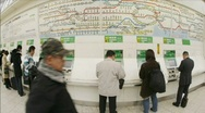 Stock Video Footage of Passengers purchase JR subway tickets in Ueno Station, Tokyo, Japan.