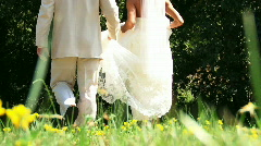 Bride and Groom in Field of Flowers - stock footage