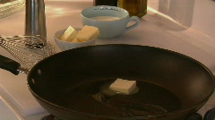 A cube of butter melts in a skillet. Stock Footage