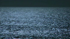 The appearance of moon light reflecting off of waves. Stock Footage