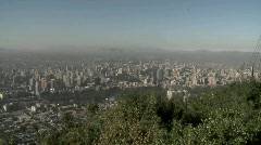 Pan across the smog filled city of Santiago to the Andes Stock Footage