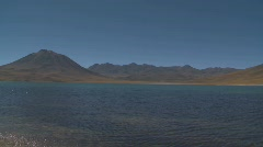 Pan across Laguna Miniques, located high above San Pedro de Stock Footage