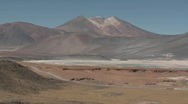 A truck passes through the colorful altiplano scenery Stock Footage
