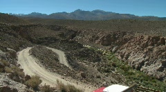 A truck on a winding dirt road in the altiplano above San Stock Footage