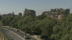 Pan across automobile traffic along the Rio Mapocho in Stock Footage