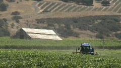 Machine pruning a Monterey County vineyard, California Stock Footage