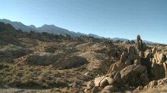 Pan across the granite rock formations of the Alabama Hills Stock Footage