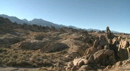 Stock Video Footage of Pan across the granite rock formations of the Alabama Hills