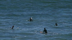 Surfers waiting for waves at Pismo Beach, California. Stock Footage